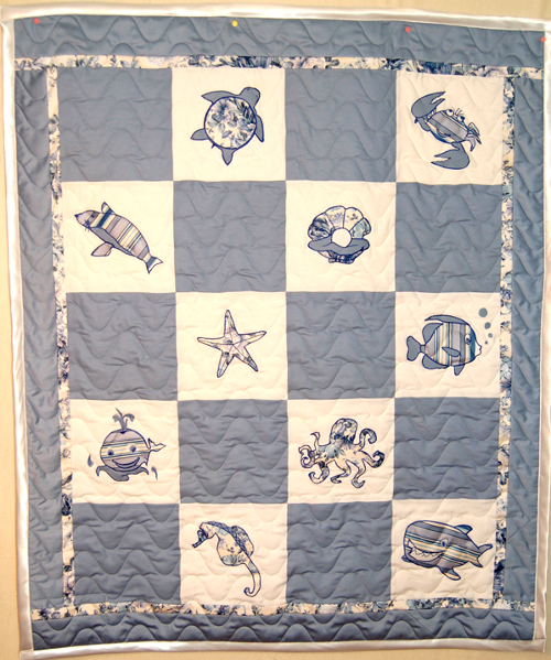 Baby quilt made from the bedclothes of his great-grandparents