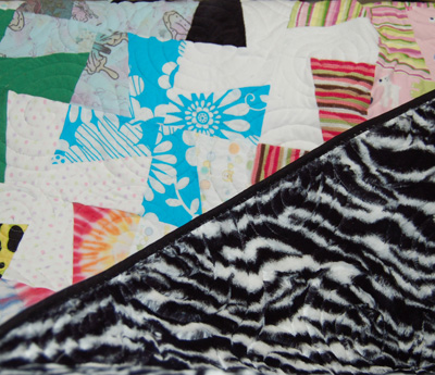 Zebra striped minky backing to small quilt