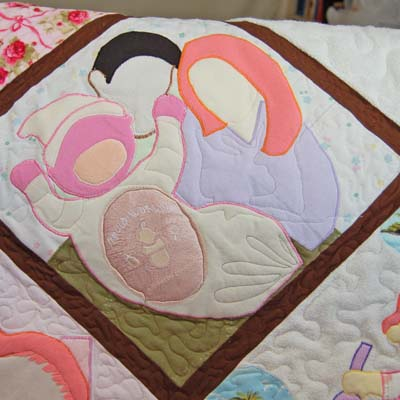 Block showing newborn's homecoming in quilt made out of baby clothes