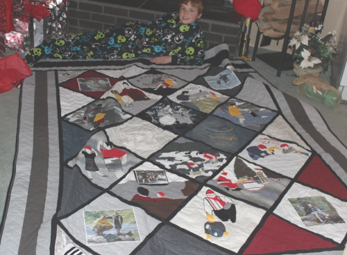 Brian with quilt made from father's clothes