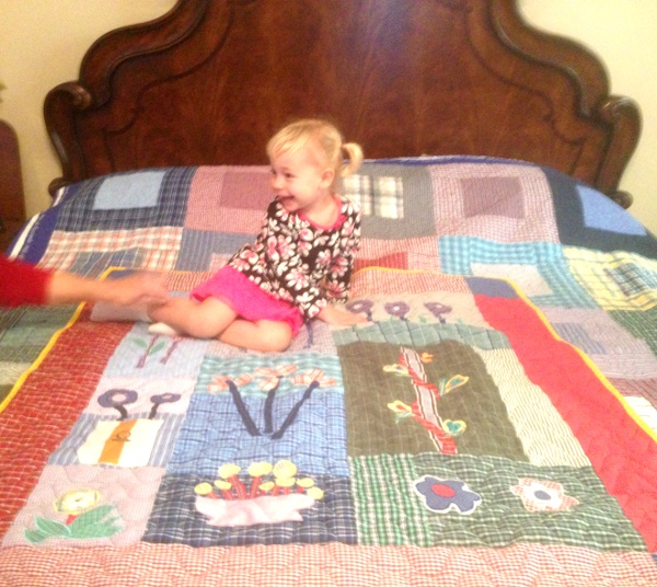 Charlotte sitting on her quilt