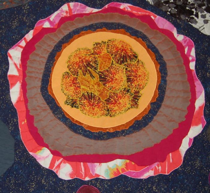 Fiery fabric sun in Eli's quasar quilt