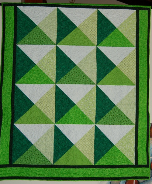 Simple tesselation quilt in greens