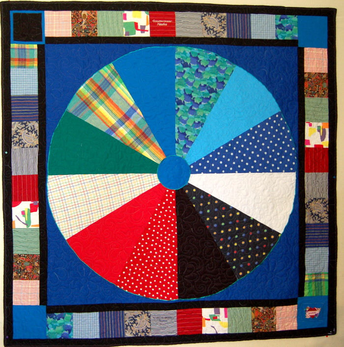 Wheel Bereavement Quilt using husband's colorful shirts