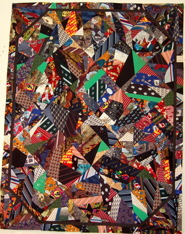 The patchwork for a tie quilt using the crazy quilt pattern