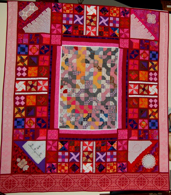 Sampler Quilt Displaying heirloom pieces of handiwork passed down from distant relatives