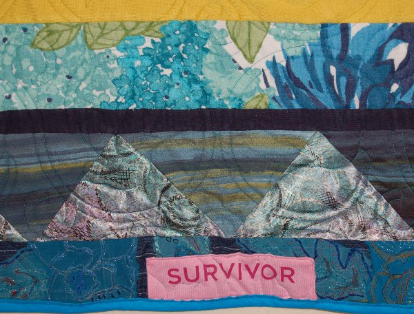 """Survivor"" caption in the border of bereavement quilt."