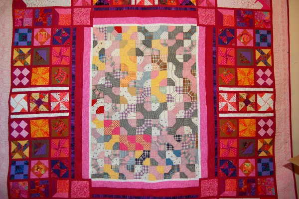 Old patchwork piece incorporated into a contemporary sampler to display many heirloom pieces