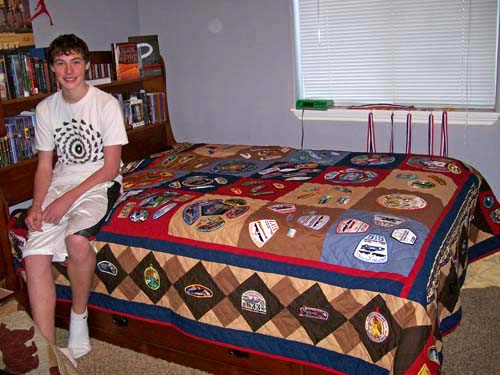 Jordan with his Scout Badge Quilt