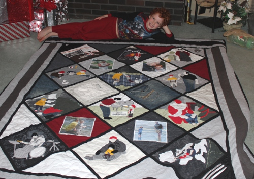 Lucas with his quilt made from father's clothes