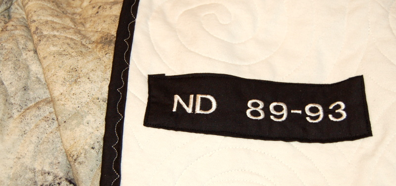 Label for College T-Shirt Quilt displaying t-shirts belonging to Mason and his Wife
