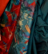 Multi-colored raincoat used to depict earth's continents in quilt