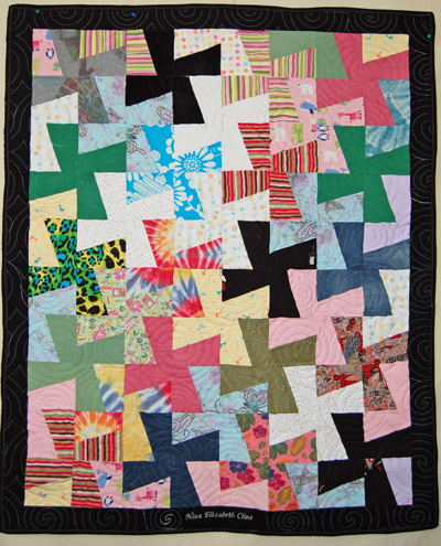 Quilt made from scraps of baby clothing