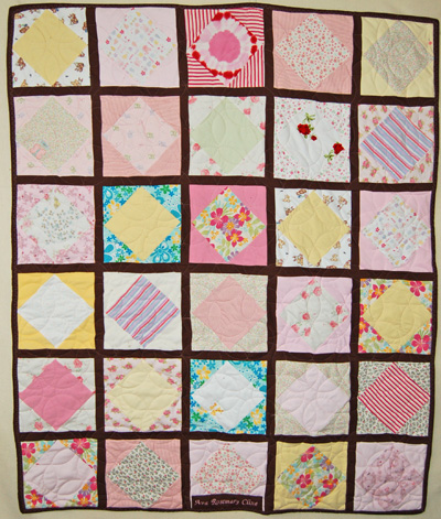 Quilt made from scraps of baby clothes
