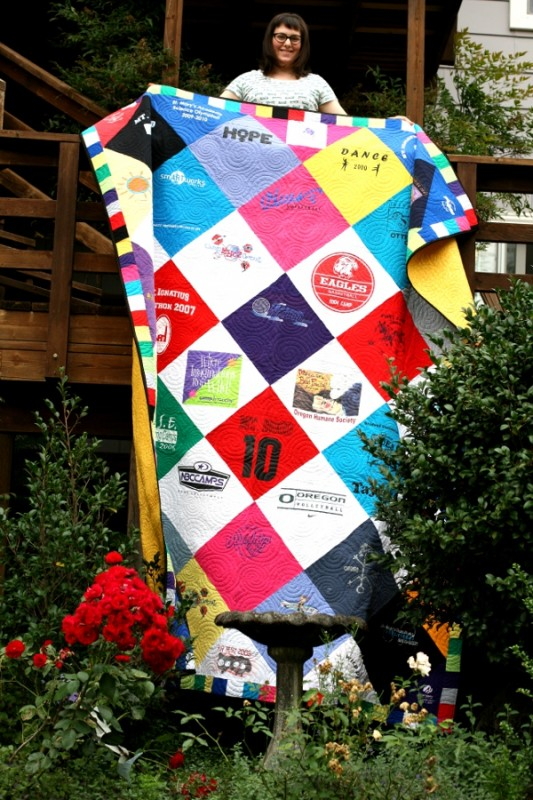 Taylor Displaying her T-Shirt Quilt