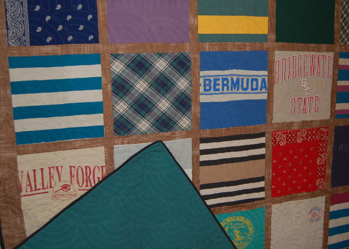 Closeup of refurbished old quilt showing backing