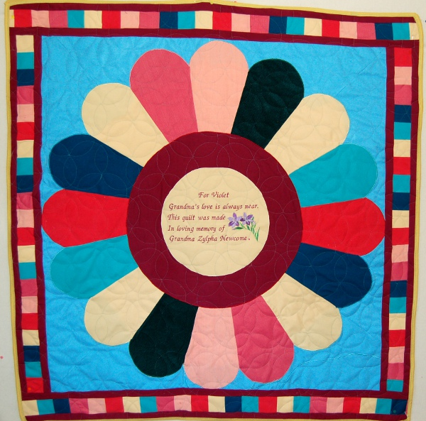 Bereavement quilt for Violet who is expected in October 2014. The quilt was made from her great-grandmother's clothes.