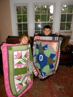 Kids with quilts made from mom's clothes