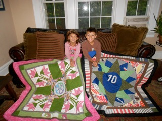 Kids with quilts made from their mom's clothes